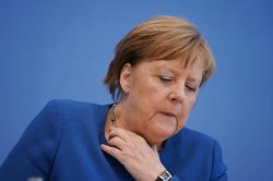 Merkel Continues Quarantine After Third Test Negative